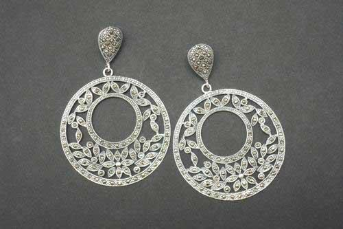 Silver and marcasistas earrings. Circle with leaves.