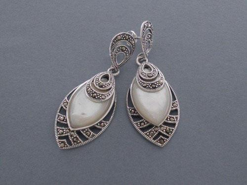 Silver earrings in shape of ogival with marcasitas and nacre