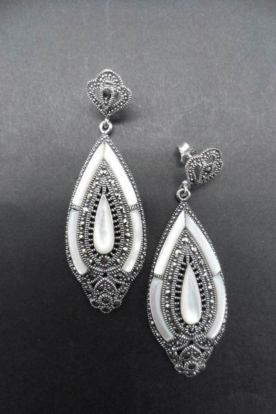 Silver and Marcasite Stone Earrings with Mother of Pearl protracted drop and details on the sides. 6cm