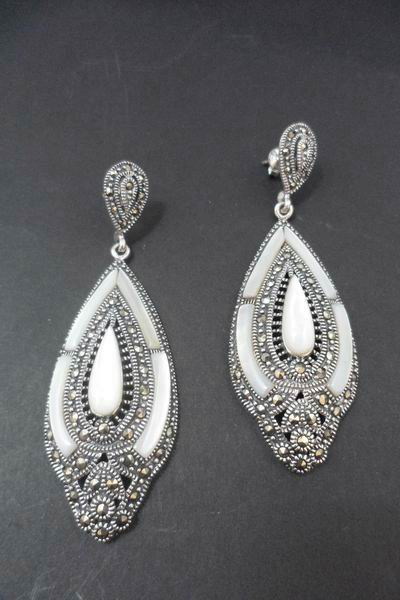 Silver and Marcasite Stones Earrings with Mother of Pearl protracted drop and details on the sides. 6cm