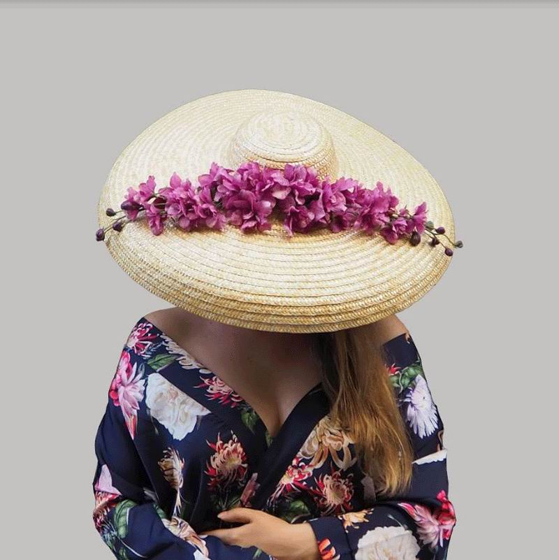 Floppy Hat in Natural Straw with a Branch of Fuchsia Flowers. Shania Model