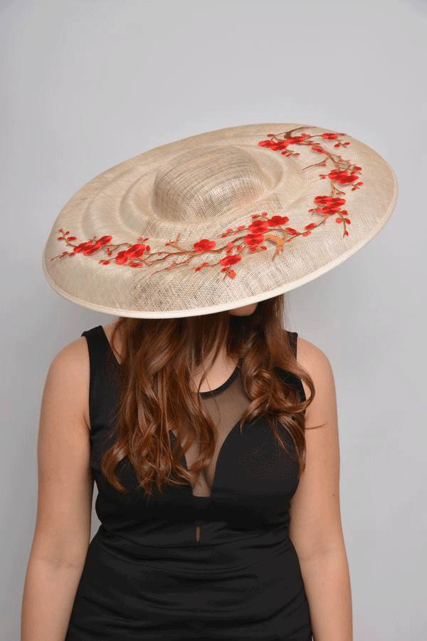 Sinamay Floppy Hat in Champagne decorated with Red Flowers. Romina