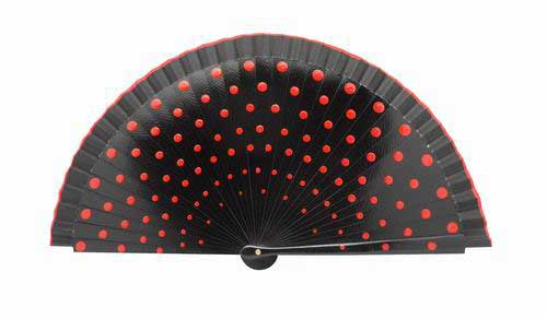 Black fan in wood painted with red polka dots on both sides.