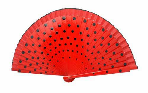 Red Fan in wood painted with black polka dots on both sides.
