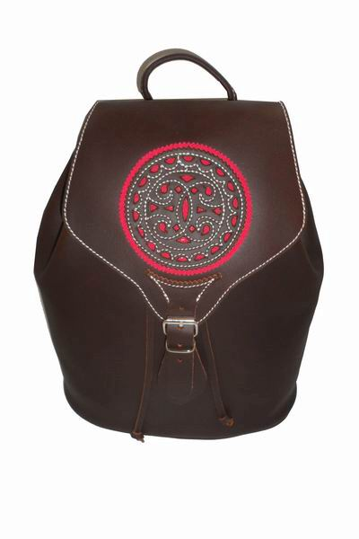 Rociero Leather Backpack with Openwork Flap with Fuchsia Background